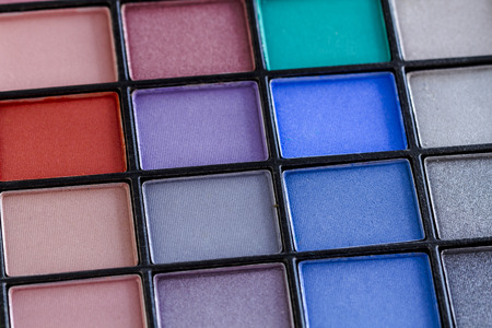 Close up of bright colorful palette of eye shadow colors
