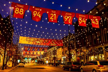 denver co: DENVER COLORADO  USA - January 17, 2016: Special light and sign display of NFL Team Denver Broncos United in Orange campaign for 2016 NFL Playoffs January 17, 2016 in Denver, Colorado