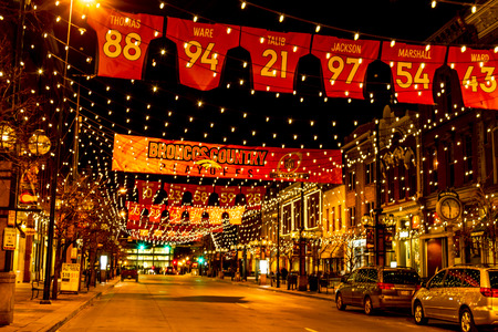 nfl: DENVER COLORADO  USA - January 17, 2016: Special light and sign display of NFL Team Denver Broncos United in Orange campaign for 2016 NFL Playoffs January 17, 2016 in Denver, Colorado