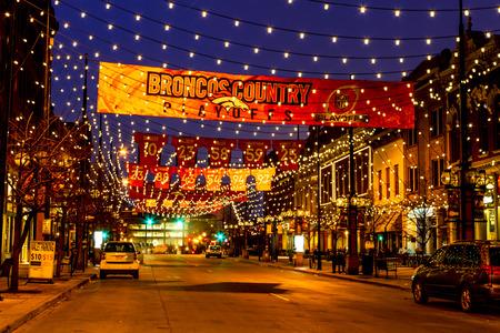 denver colorado: DENVER COLORADO  USA - January 17, 2016: Special light and sign display of NFL Team Denver Broncos United in Orange campaign for 2016 NFL Playoffs January 17, 2016 in Denver, Colorado