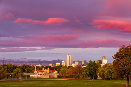 city park boat house: Denver Colorado skyline from City Park with City Park Boathouse and Rocky Mountains in background on autumn morning