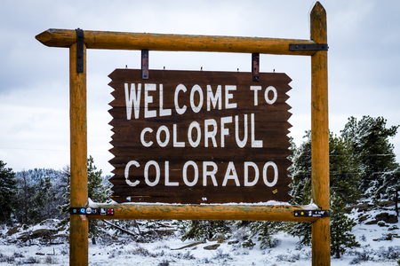 colorado state: Welcome to Colorful Colorado state sign on highway upon entering state border of Colorado Editorial