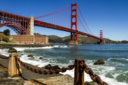 chain fence: Golden Gate Bridge in San Francisco California from Fort Point National Historic Site with rusted chain fence along water