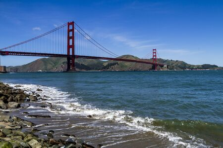 national historic site: Golden Gate Bridge in San Francisco California from Fort Point National Historic Site waterfront park Editorial