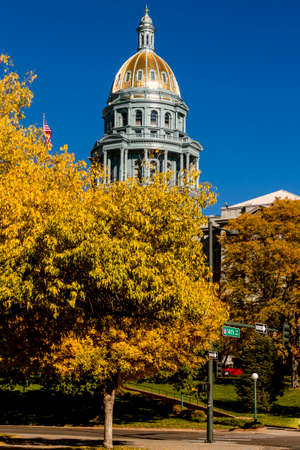 denver co: Colorado USA State Capitol Building in Denver, CO on sunny autumn morning with changing tree around building Stock Photo