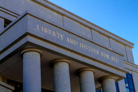 co: Close up of the front of the Federal Court Building in Denver, CO with saying Liberty and Justice for All Stock Photo
