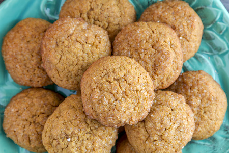 fresh baked: Close up of fresh baked pumpkin spice cookies sitting on blue pumpkin shaped plate