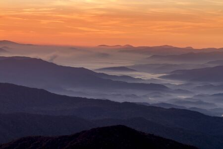great smokies: Dramatic sunrise sky with hazy mountain layers and fog at Clingmans Dome in Great Smoky Mountains National Park Stock Photo