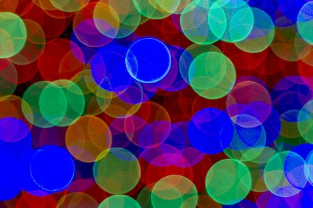 Abstract circular bokeh background of multi-colored holiday lights