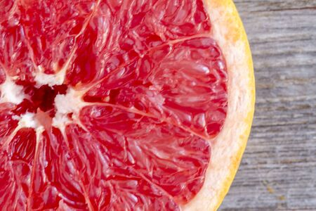 macro shot fresh organic ruby red grapefruit half stock photo