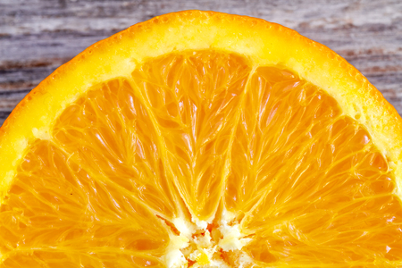 Macro shot of the inside of fresh organic navel orange half Stock Photo