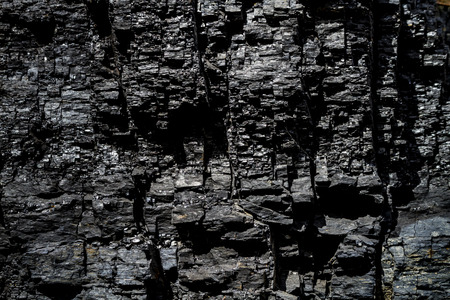 Black coal in rock textured background Stock Photo
