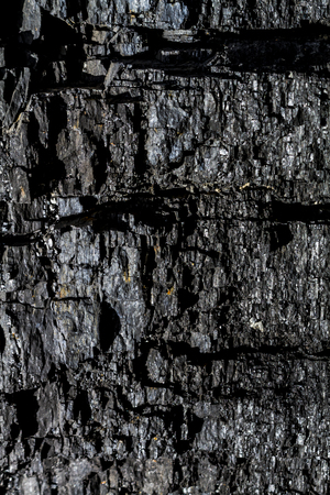 Background of black coal in rock canyon wall