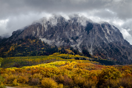 Marcellina Mountain along Kebler Pass during autumn with changing yellow aspen trees and dramatic clouds