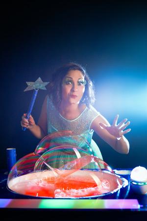 creates: Girl with magic wound creates bubbles magic