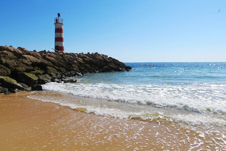praia: View of the Lighthouse - Praia de Faro, Portugal, Algarve