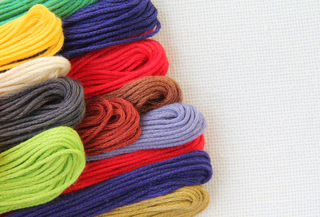 cotton thread: Floss and fabric for embroidery colored cotton thread Stock Photo