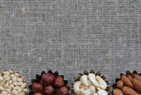 durability: Abstract image of nuts on fabric texture Stock Photo