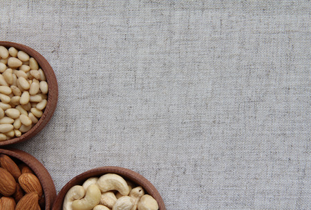 Abstract image of nuts on fabric texture photo