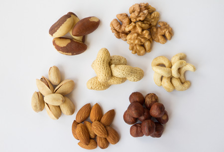 durability: Assorted nuts on a white background
