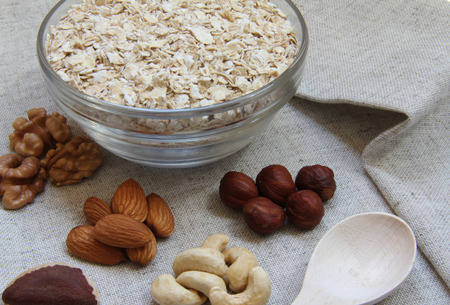 particularly: Particularly gentle oatmeal with nuts on natural fabric Stock Photo