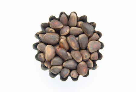 pinoli: Manciata di pinoli in forma figurato