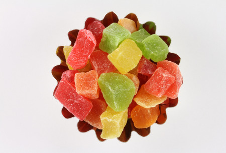 candied fruits: Dried pineapple candied fruits in curly form on a white background