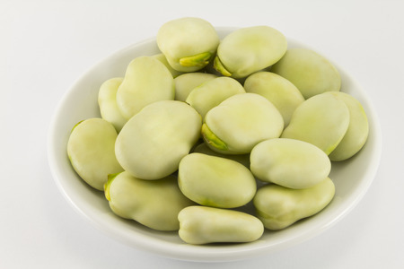 lysine: Beans on a saucer on a white background