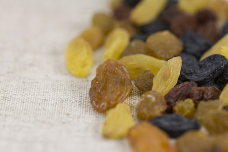 sultana: Assorted raisins against a background of natural gray fabric