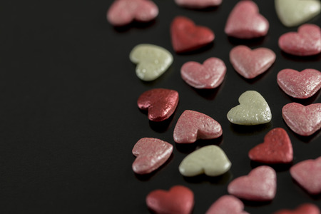 feel feeling: Valentines Day - colored hearts on a black background Stock Photo