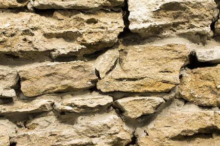 porous brick: The texture of the stone wall of the porous surface, horizontal shot Stock Photo
