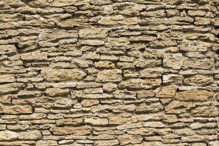 La textura de la pared de piedra de la superficie porosa, tiro horizontal Foto de archivo