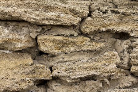 porous: The texture of the stone wall of the porous surface, horizontal shot Stock Photo
