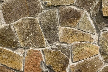 rock wall: Horizontal stone wall of a nature rock - close up