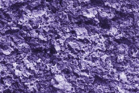The texture of the stone wall of the porous surface, horizontal shot (photo is toned in ultra violet)