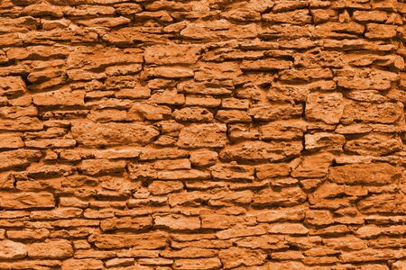 The texture of the stone wall of the porous surface, horizontal shot (toning in autumn maple)
