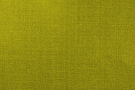 Natural linen fabric for embroidery. Toning in pantone color golden lime. Archivio Fotografico - 98176914
