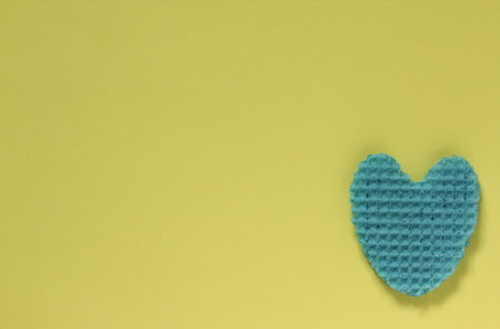 Creative heart from an edible wafer in blue pastel  color. Abstraction. Template. Top view.