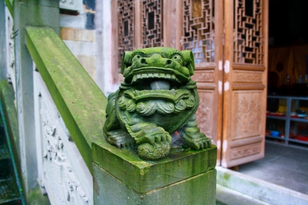 Old stone lion. Tushan temple. Chongqinq. China. photo