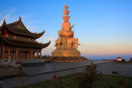 Golden statue and temple in the top of the Mt. Emeishan. Sichuan. China.