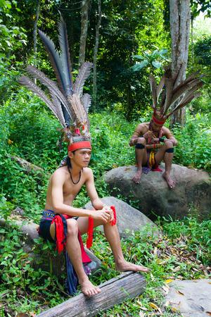 aborigines: Malaysian aborigines in national costumes, Borneo island, Malaysia.