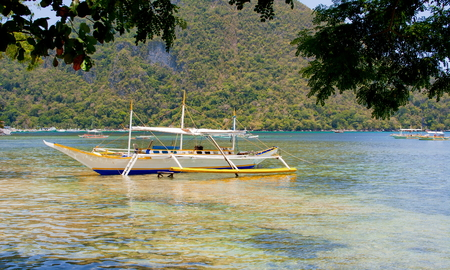 Traditional Philippine boat on the beach. Stock Photo