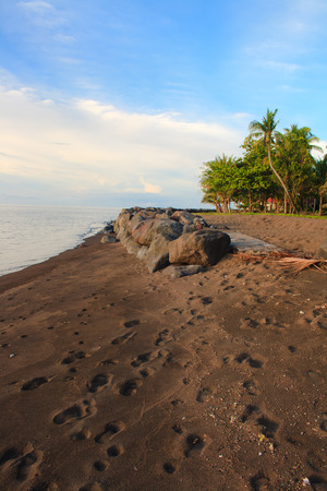 The beach of black sand. Camiguin Island. Philippines.