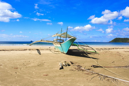 A traditional Philippine boat on the beach of Nagtabon. The island of Palawan. Philippines. Banco de Imagens