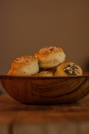 Mini pastries with sesame and oregano served in bamboo bowl
