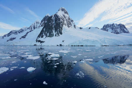 This is summer in Pleneau Island, Antarctic Peninsula. There are penguins, whales, icebergs, ice floes, glaciers, oceans, radioactive clouds and sunlight.