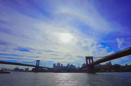 Brooklyn Bridge under blue sky and white clouds, view of city buildings.A famous view of New York City, U.S.A. October 2016. Standard-Bild