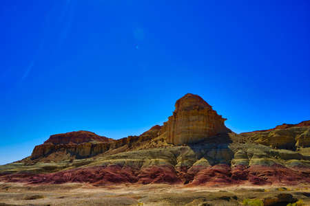 Wind eroded square hills, minarets, peaks, Efege mounds. Clean blue sky. Stunning wind-eroded yellow landform landscape. Devil(Ghost) City, Xinjiang China. Sep. 2018