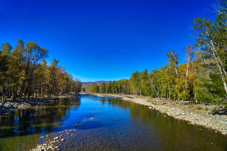 Poetic landscapes, clean blue skies, clear rivers, and lush trees, canyon. Picturesque natural landscape. Keketuohai Scenic Area. Xinjiang, China. 2018