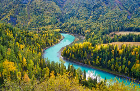 Moon Bay of Kanas Lake. The curved river with crystal blue water. Green trees. The natural beauty of the paradise. Kanas Nature Reserve. Xinjiang Province, China. Sep. 2018